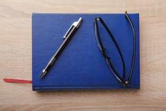 Notebook on the desk Stock Photos