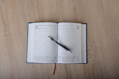Notebook on the desk Royalty Free Stock Photos