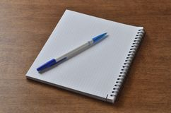 Notebook on the desk with a pen for writing stock image