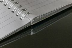 Notebook on the desk Stock Photography