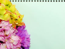 Notebook diary and beautiful artificial Hydrangeas flower bouquet background Royalty Free Stock Image