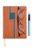 Notebook or diary, glasses and pen Stock Images