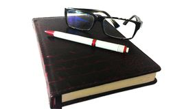 Notebook diary, glasses and pen included Stock Photos
