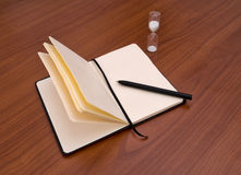 Notebook, diary, pen and timer. No inspiration. Deadline, writers block concept Royalty Free Stock Photos