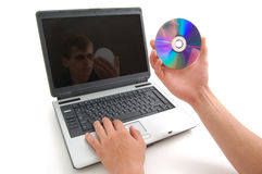 Notebook and disk Stock Image