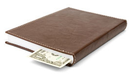 Notebook with dollar Stock Photo