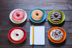 Notebook and donuts Royalty Free Stock Photography