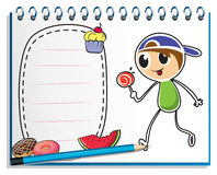 A notebook with a drawing of a boy eating a  lollipop candy Stock Photography