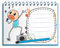 A notebook with a drawing of a boy singing Stock Photo