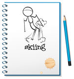 A notebook with a drawing of a boy skiing Stock Image