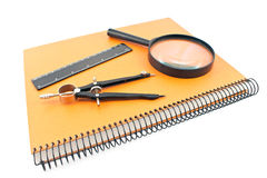 Notebook with drawing compass, ruler and magnifier Royalty Free Stock Photo