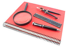 Notebook with drawing compass, ruler, pen and magn Stock Photography