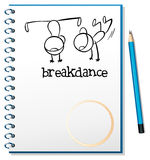 A notebook with a drawing of two boys breakdancing Stock Image