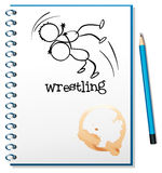 A notebook with a drawing of a wrestler Stock Image
