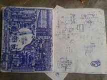 Notebook with schematic drawings royalty free stock image