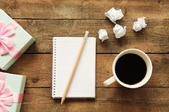 Notebook with drinking coffee on wooden table Stock Photography