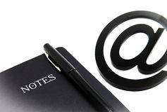 Notebook and e-mail symbol Royalty Free Stock Photography