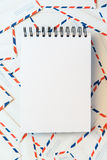 Notebook on a envelope background. Notebook paper on envelope background stock image