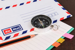 Notebook, envelopes airmail, notebook, compass and pencil on woo Stock Photography