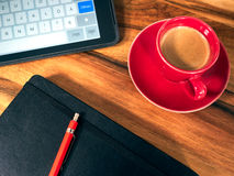 Notebook with espresso cup Royalty Free Stock Image