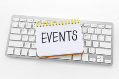 Notebook with events word on keyboard. Notebook with events word on computer keyboard with white background stock image