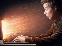 Notebook Explosion. Man sittíng in front of exploding notebook Stock Image