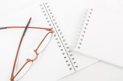 Notebook and eyeglass Royalty Free Stock Photo