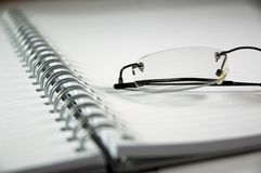 Notebook and eyeglasses Stock Photo