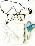 Notebook, eyeglasses, scissors (office tools) Royalty Free Stock Images