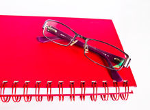 Notebook and eyeglasses. Royalty Free Stock Image