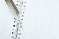 Notebook and feather Stock Image