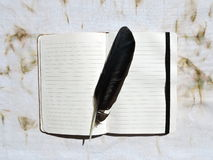 Notebook and feather Royalty Free Stock Images