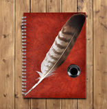 Notebook and feather with ink bottle Royalty Free Stock Photography