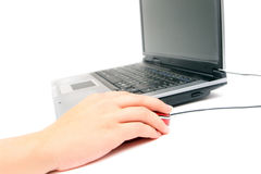 Notebook and female hand holding red mouse. Computer and female hand holding red mouse Stock Photo