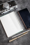 Notebook with film camera. Royalty Free Stock Photos