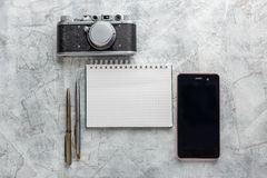Notebook with film camera. Royalty Free Stock Images