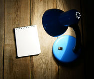 Notebook and the fixture. On wooden background. Stock Image