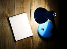 Notebook and the fixture. On wooden background. Stock Images