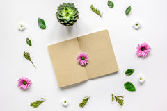 Notebook with flower petals on white table background top view mock-up Royalty Free Stock Photos