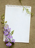 Notebook and flowers Stock Images