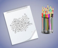Notebook with flowers and colored pencils Royalty Free Stock Photo