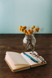 Notebook  and flowers Royalty Free Stock Image
