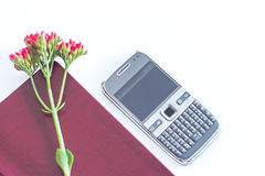 Notebook with flowers on a mobile phone Royalty Free Stock Image