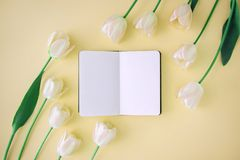 Notebook and flowers Royalty Free Stock Images