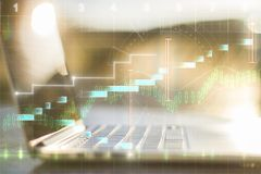 Notebook with forex chart. On blurry outdoor background. Finance and trade concept. Double exposure Stock Image