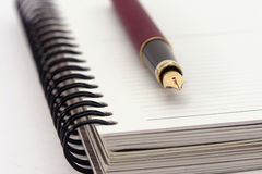 Notebook and fountain pen. Whit shallow depth of field Royalty Free Stock Images