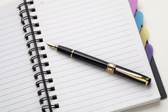 Notebook with fountain pen. Notebook and pen  on a white background Royalty Free Stock Photos
