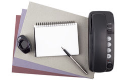 Notebook, fountain pen, ink and phone on textured paper Royalty Free Stock Images