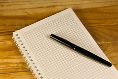 Notebook with the fountain pen on a wooden desk Royalty Free Stock Photography