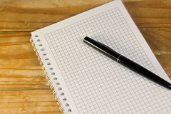 Notebook with the fountain pen on a wooden desk Royalty Free Stock Image